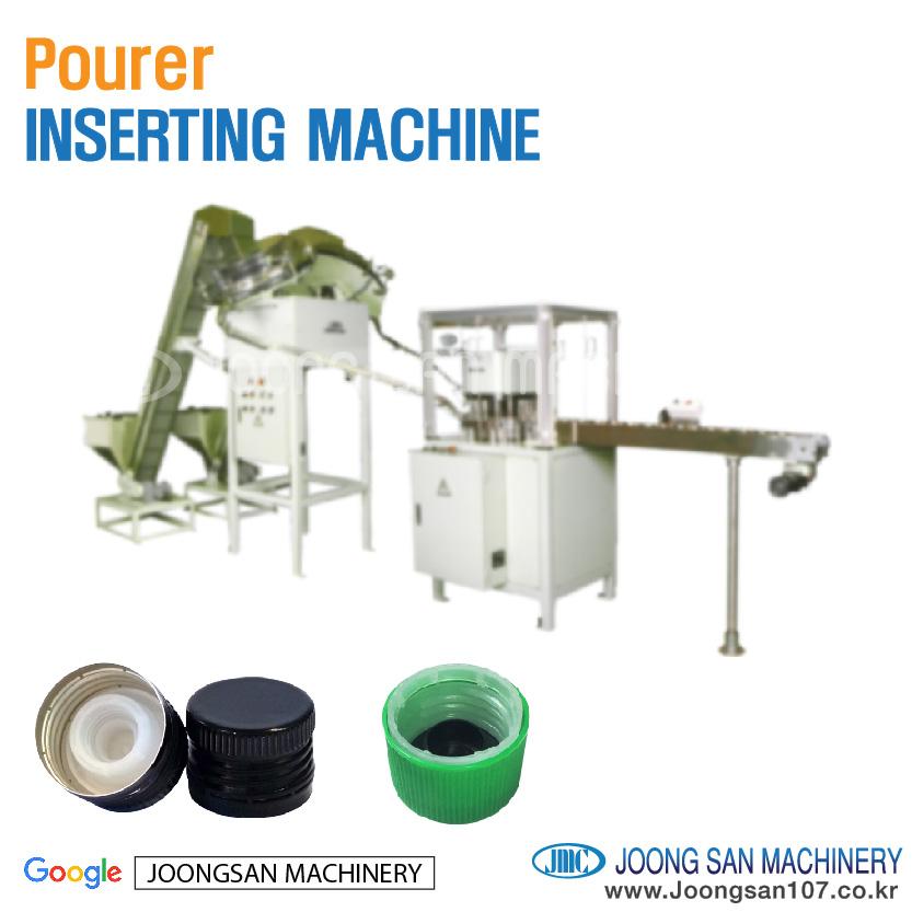 Pourer cap inserting machine