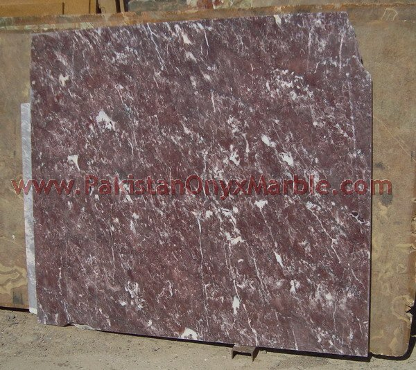 RED AND WHITE MARBLE SLABS