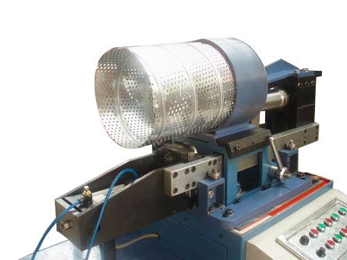Spiral perforated duct machines