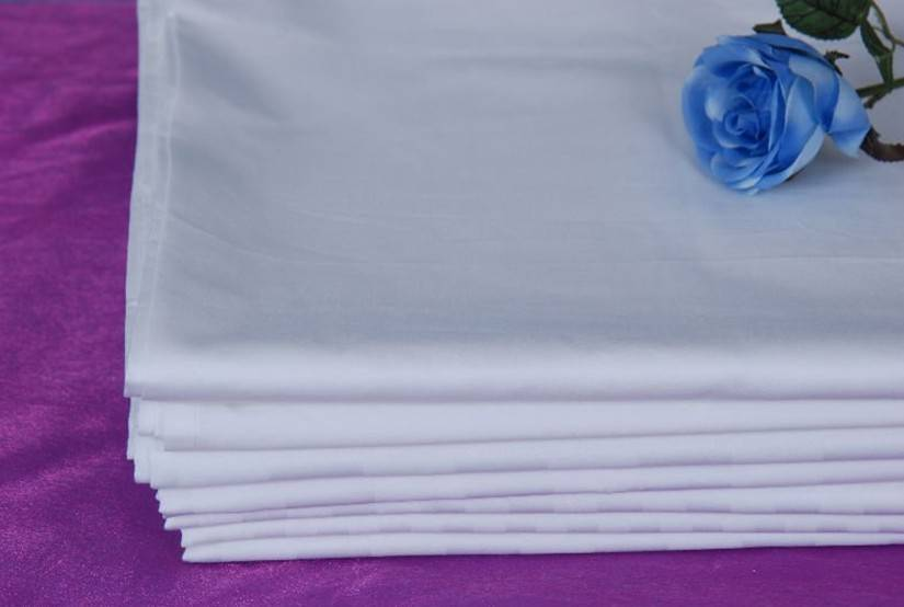 plain white hotel bed cover