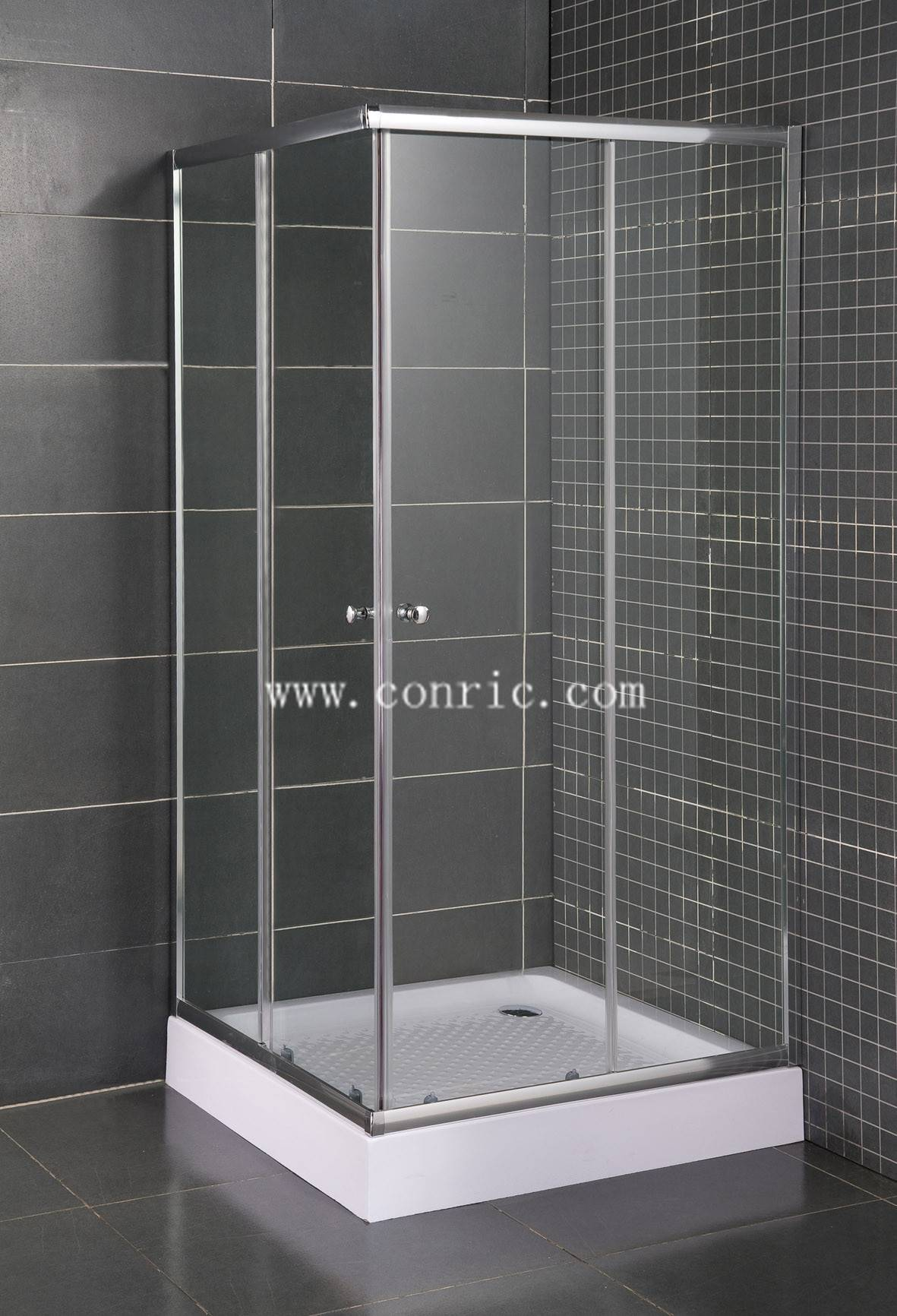 Simple corner shower enclosure with chrome aluminum profile