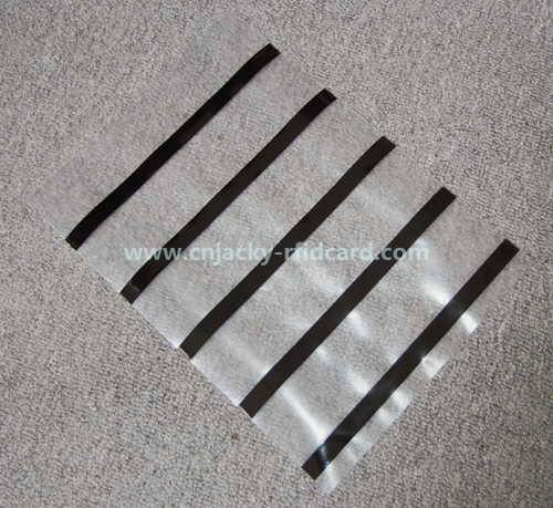 coated overlay with magnetic strip