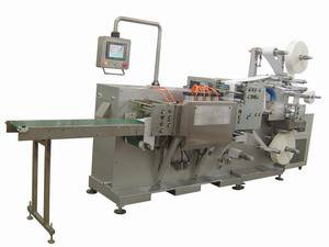 Surgical paraffin gauze dressing packaging machine