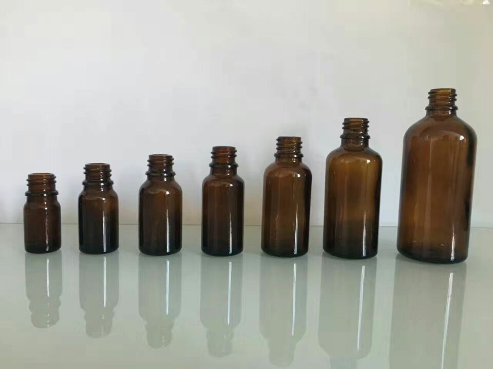 Essential oil glass bottles with amber color green color blue color