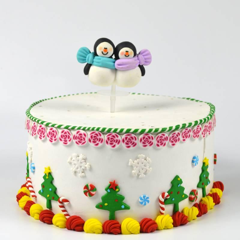 Christmas penguin couple cake decorating