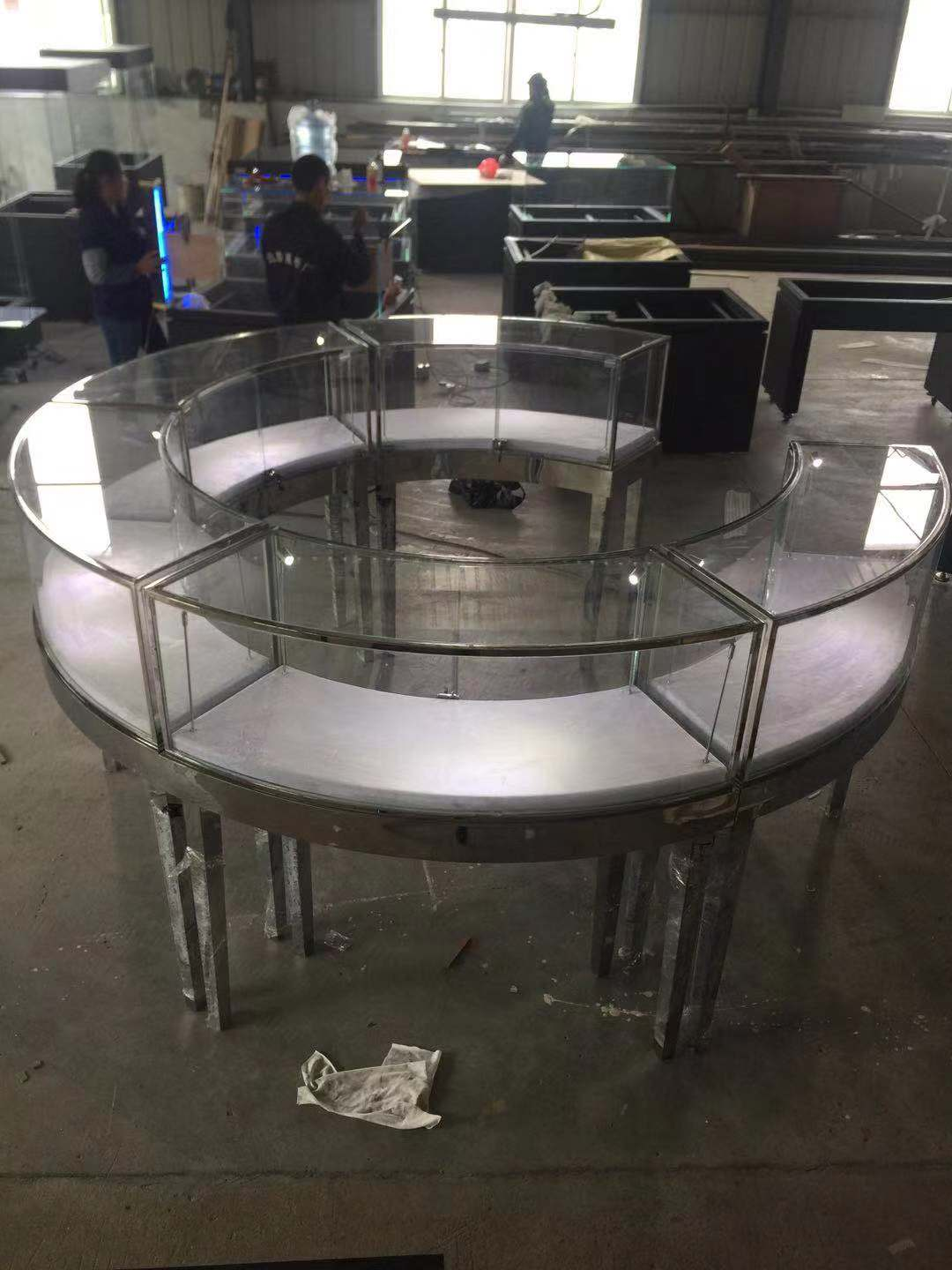 round jewelry kiosk and steel jewelry display table