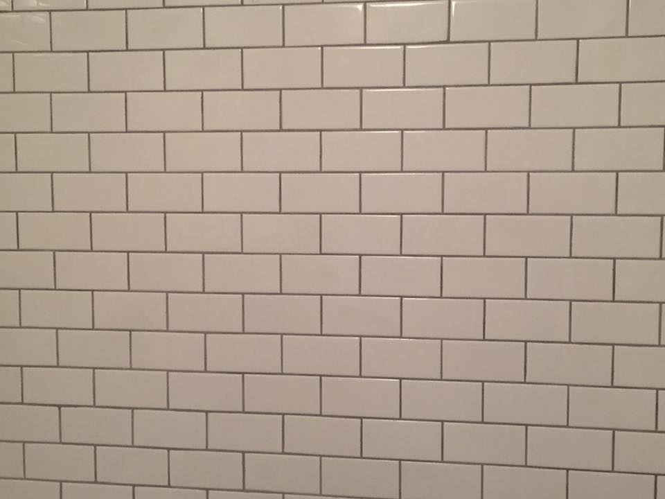 white glossy subway tile for wall and floor