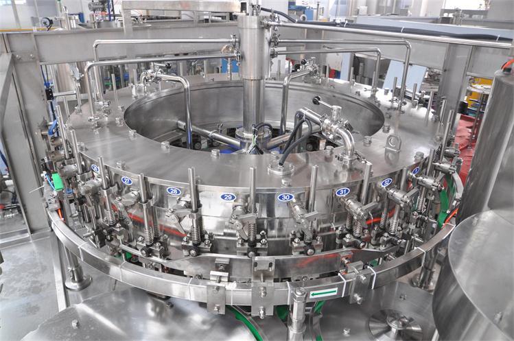 CARBONATD DRINK FILLING MACHINE