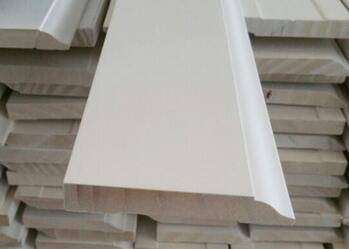 Primed finger joint baseboard pine moulding
