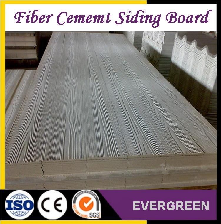 Wood fiber cement siding board