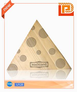 triangular cheese chopping board with pattern on surface