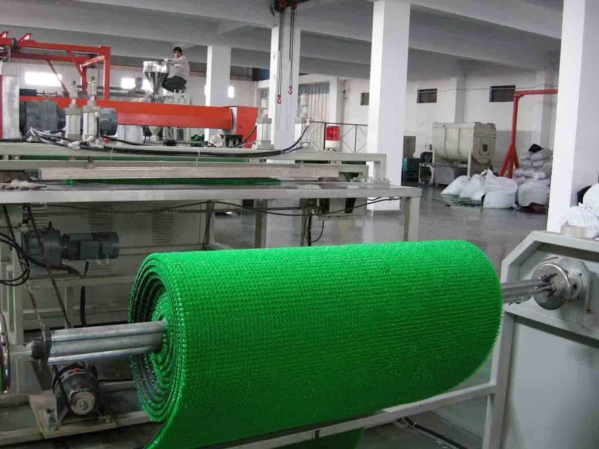 Man-made grass mat machine