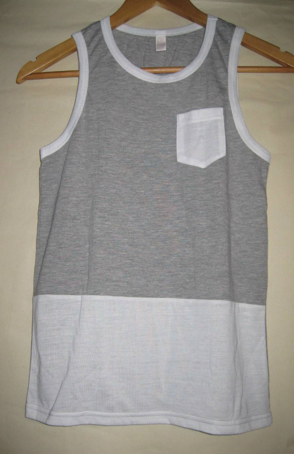 Children's vest with pocket and combination