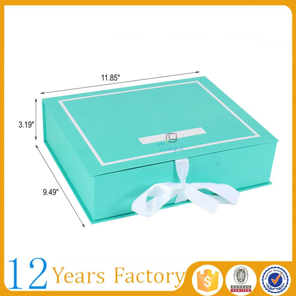 green color paper gift box with ribbon