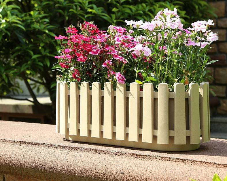 Wooden fence style planter