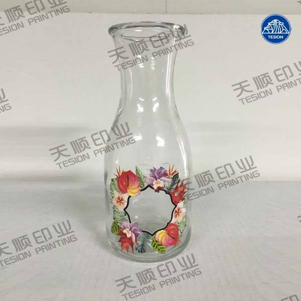 Heat transfer film for glass bottles