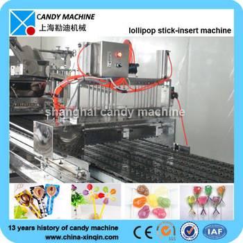 Servo controlled lollipop machine