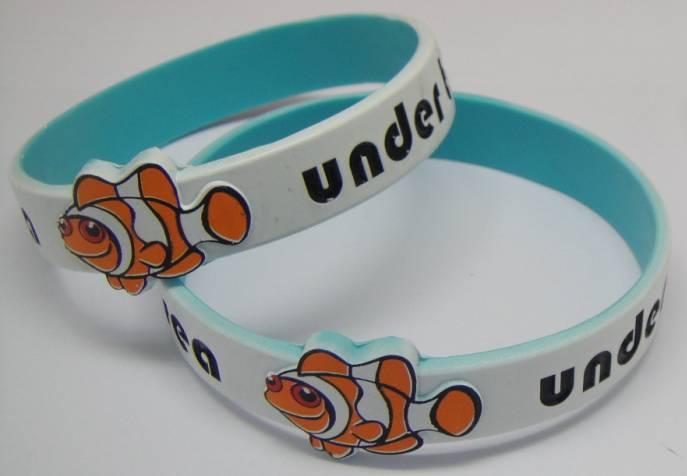 spray coated silicone wristband with embossed goldfish printing