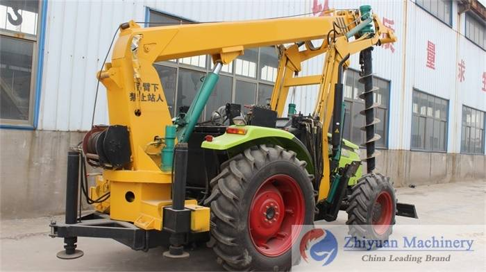 Hydraulic controlling system post hole digger with crane