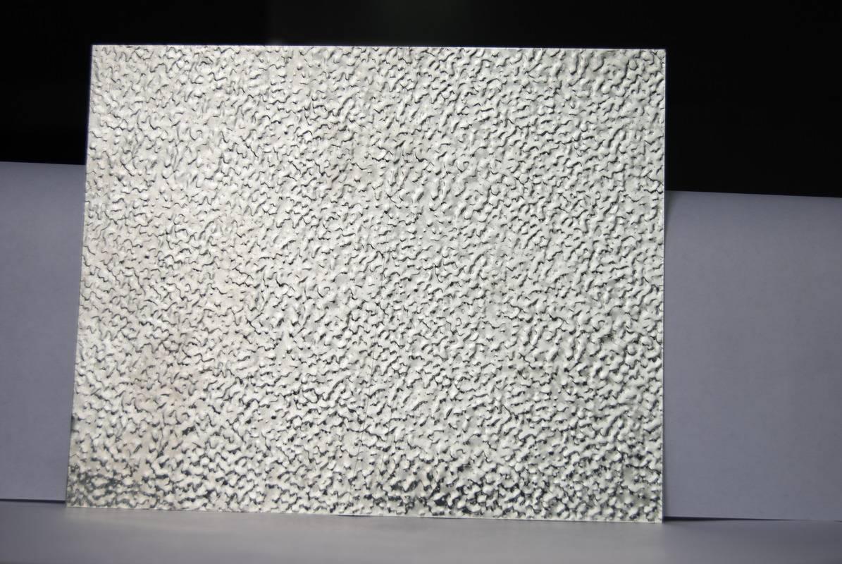 Textured embossed aluminum sheet