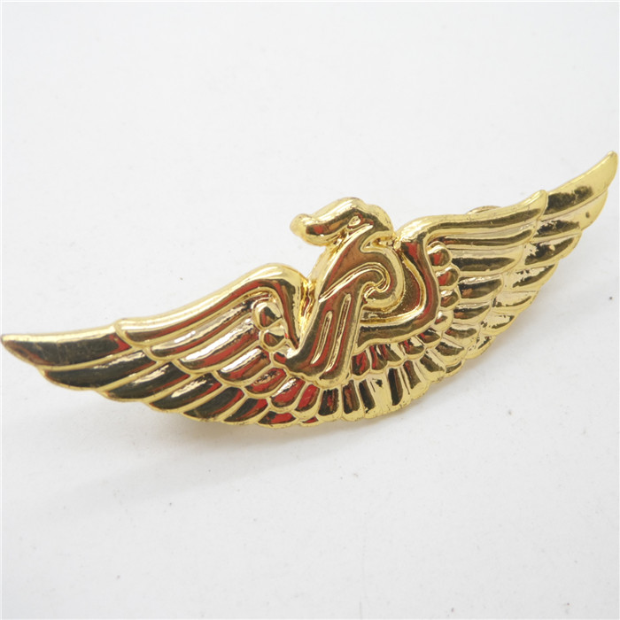 Metal wings badge