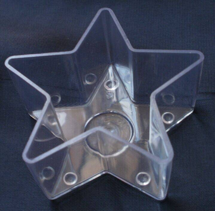 flame-proof plastic candle holder of five pointed star shape