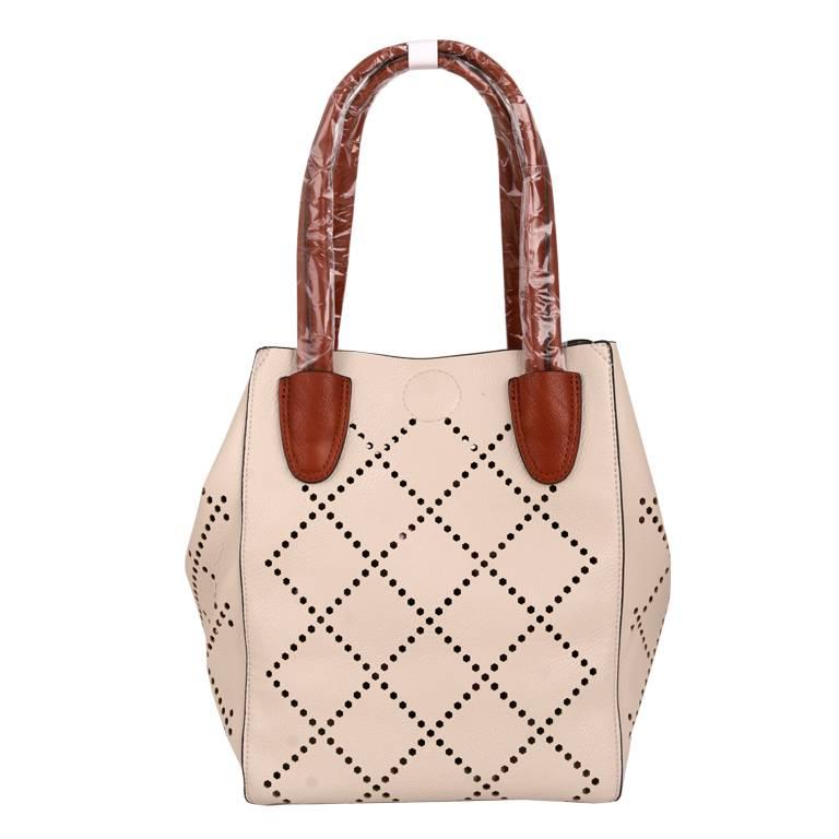 Laser cut ladies handbag