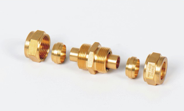 Brass bite type fitting compression fitting with core