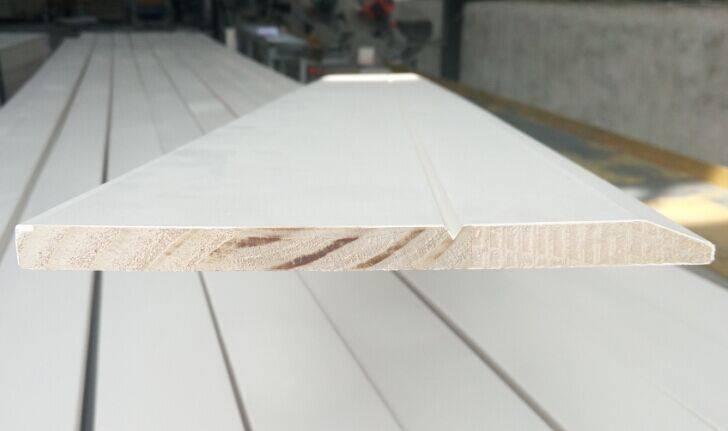 White gesso hardwood baseboard 8-16'