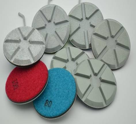 Ceramic bond grinding pad