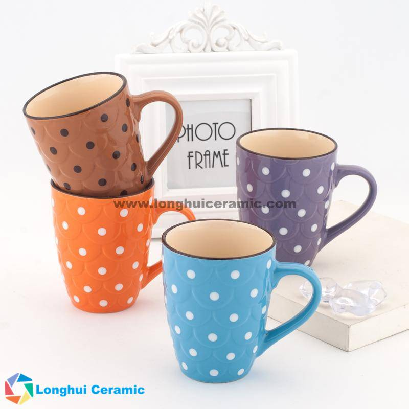 Embossed ceramic mug with color glaze and white dots painted