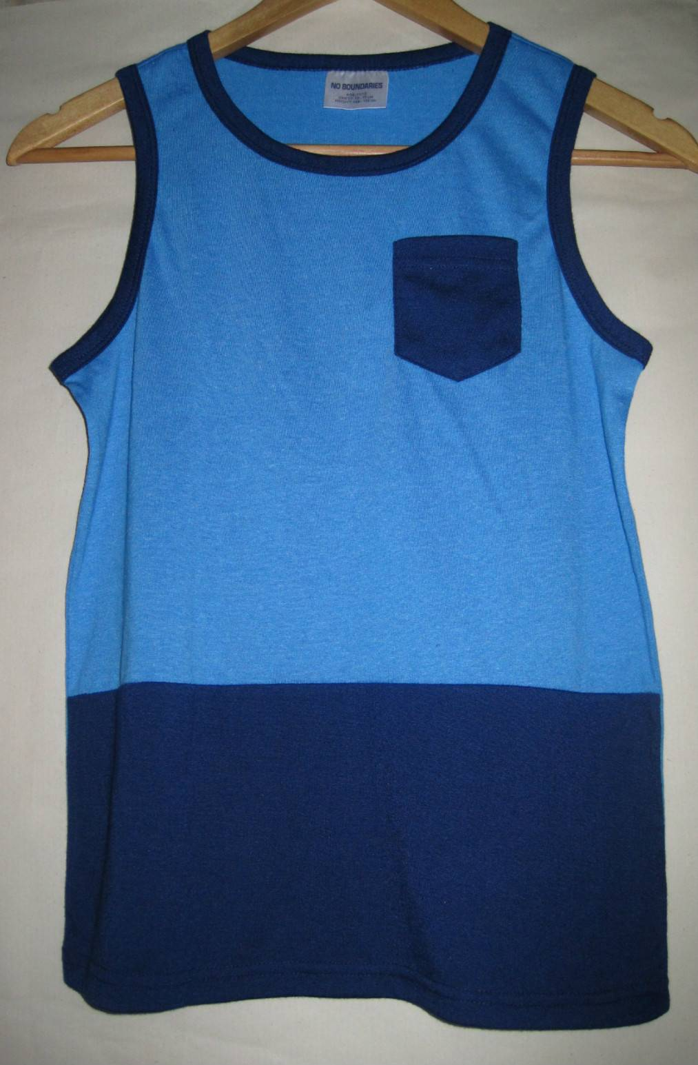 Children's tank top with pocket and combination