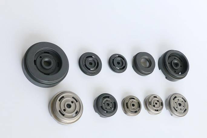 Powder metal foot valve for shock absorber