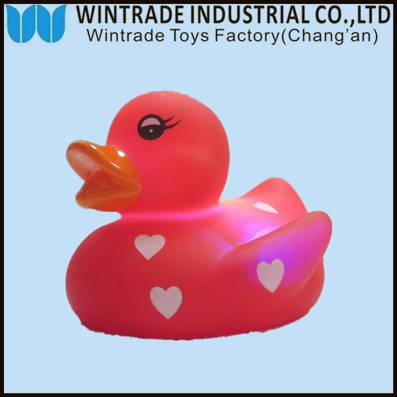 rubber bath duck toy floating