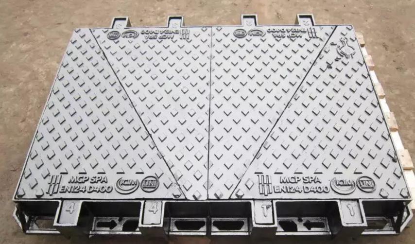 Ductile cast iron telecom manhole cover