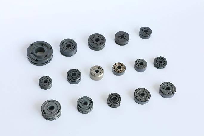 Powder metallurgy piston for shock absorber