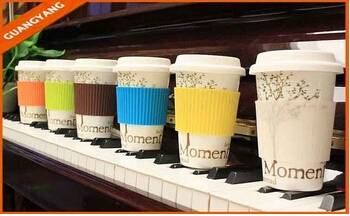 2015 new design single wall ceramic coffee travel mug with silicone lid and sleeve  See larger image