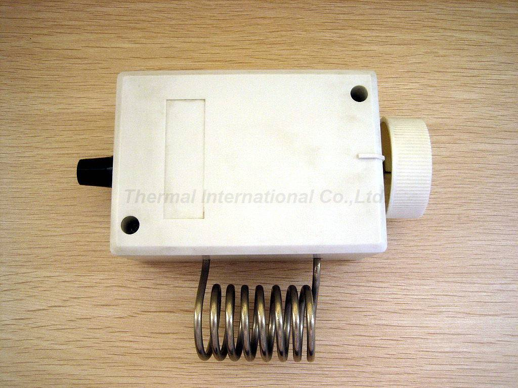White Capillary Thermostat Housing with Plastic Material