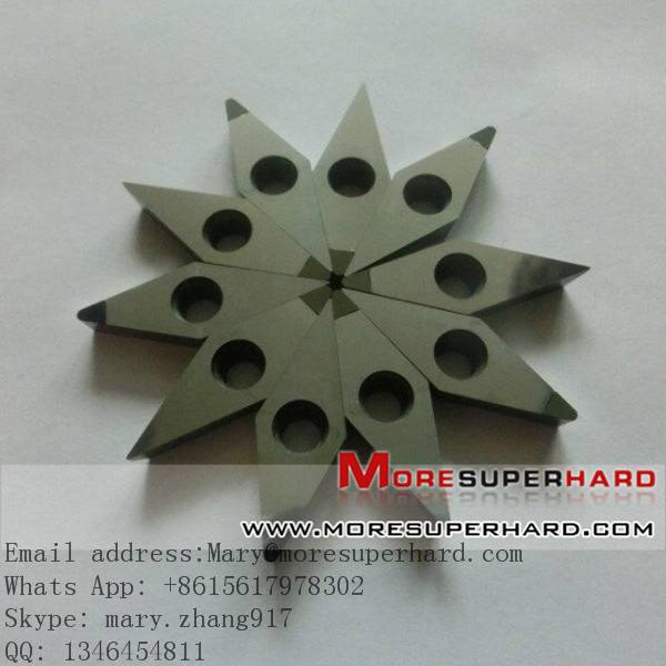 PCD cutting inserts and grooving tools for roll