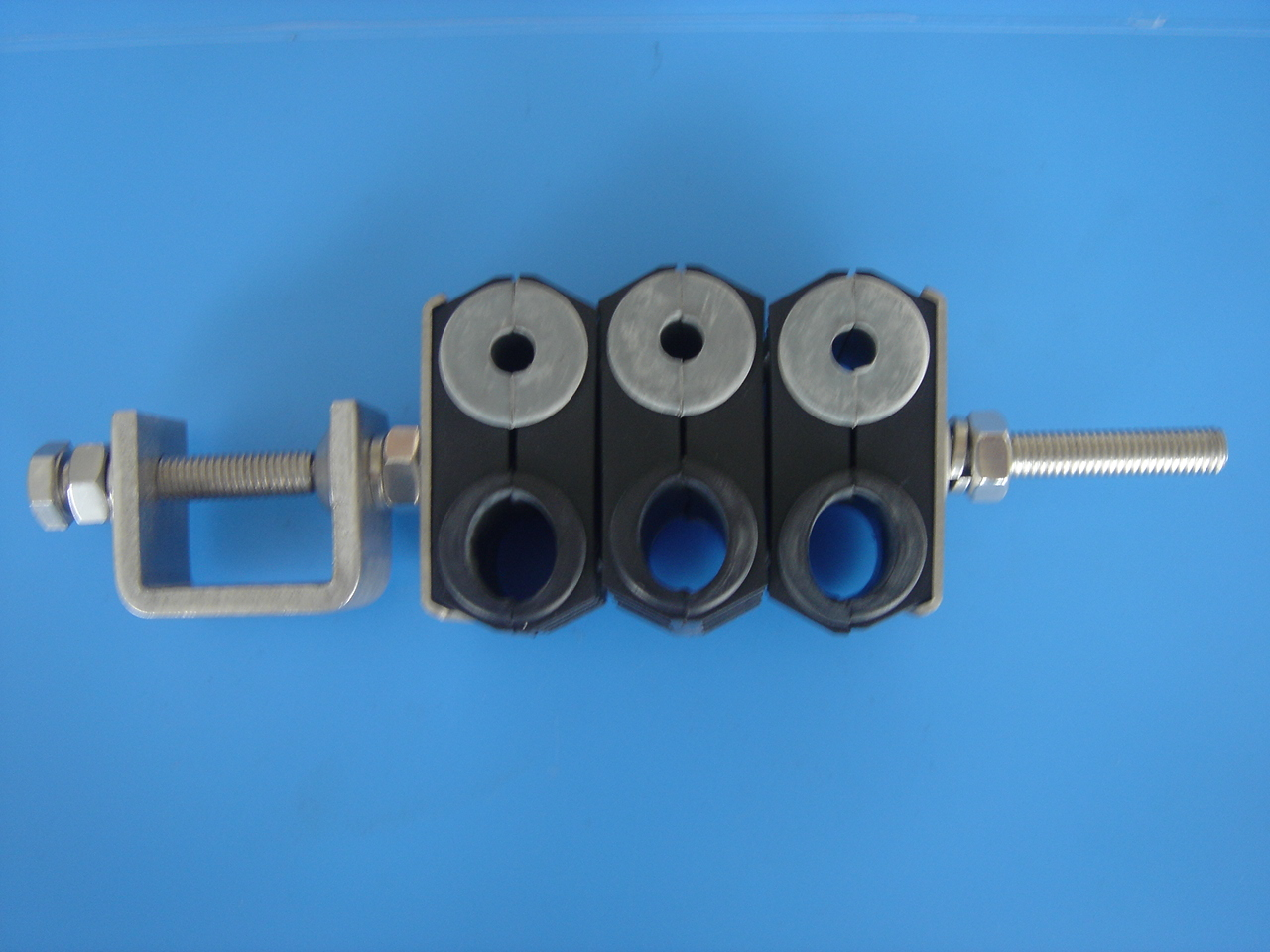 cable clamp for 3 power cables and 3 fiber optic cables