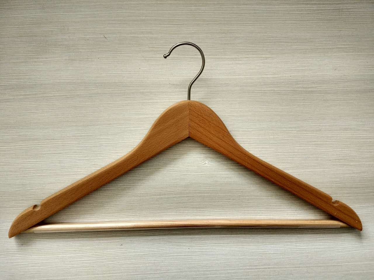 Natural wooden coat hanger with non-slip bar