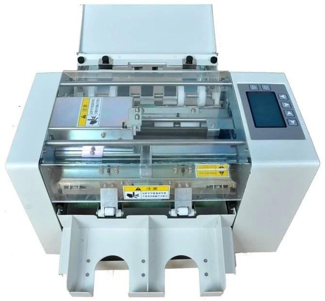 AUTOMATIC PAPER CUTING MACHINE