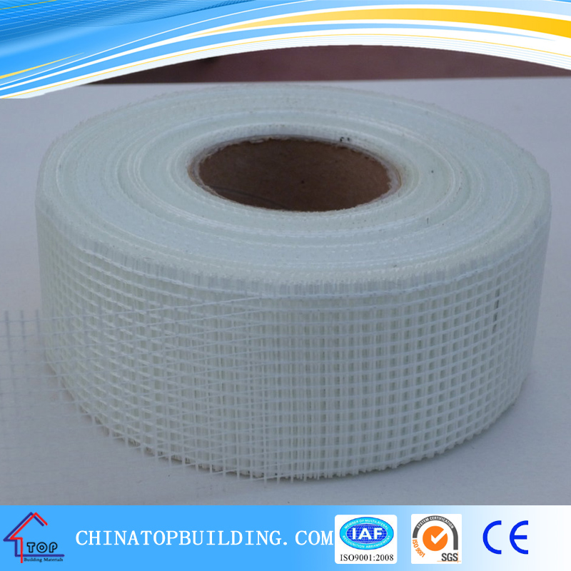 Adhesive fiberglass mesh tape for drywall