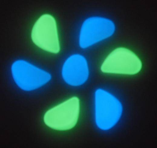 Glow in the dark stone in yellow-green, blue-green, sky-blue