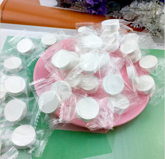 white small coin magic towe lcompressed towel