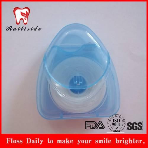 tramsparent blue triangle shape dental floss