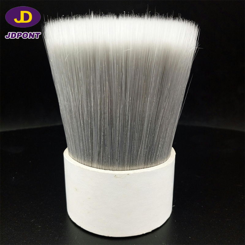 white and grey crimped synthetic brush filament