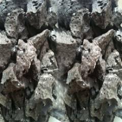 Fused calcium ferrite