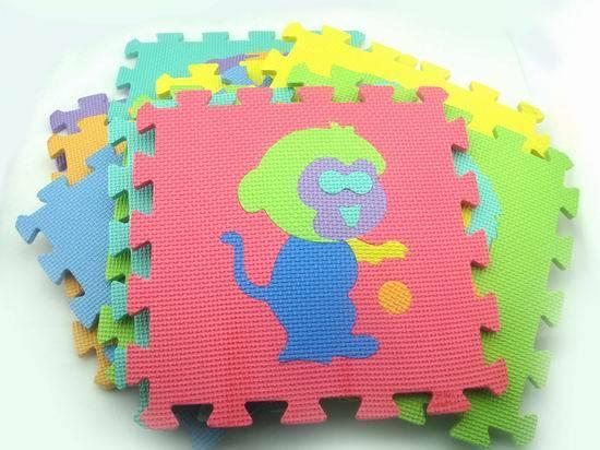 child using eva animal puzzle mat