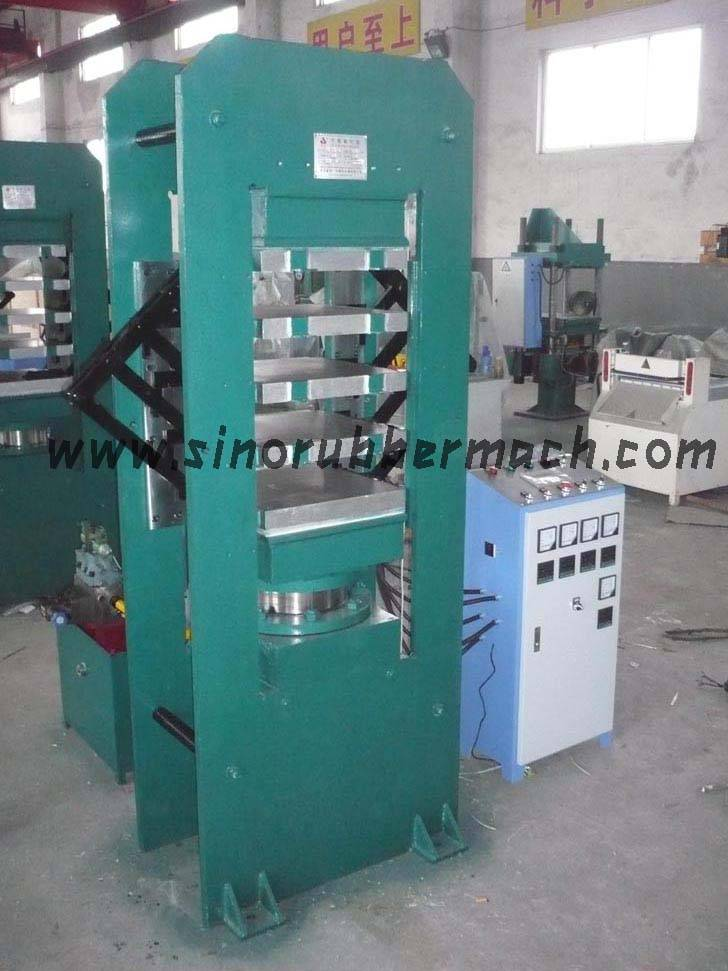 Frame type rubber plate vulcanizing machine